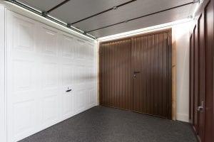 white panelled garage door and brown panelled garage doors