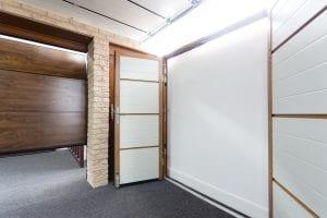 white double garage doors and brown panelled garage door