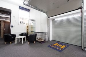 showroom with waiting area and white roller door