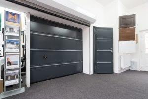 showroom with grey garage door, grey security door, samples and brochures