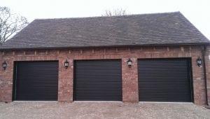 three black electric roller garage doors