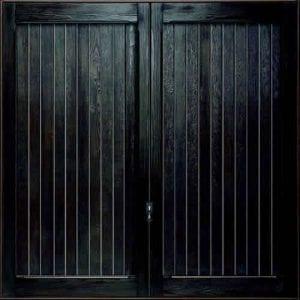 GRP Up and Overs garage door in a dark green colour.