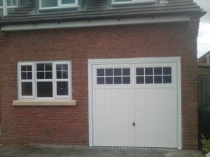 white up and over garage door with glass panels